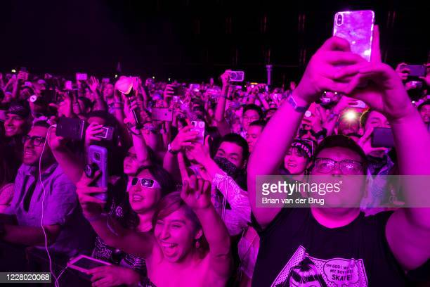 Fans watch BLACKPINK on the Sahara stage at the Coachella Valley Music and Arts Festival on the Empire Polo Club grounds in Indio, Calif., on April...