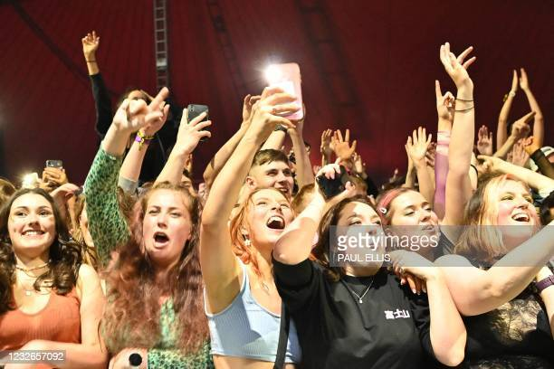 Fans watch Blossom perform at a live music concert hosted by Festival Republic in Sefton Park in Liverpool, north-west England on May 2 where a...