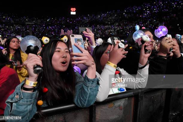 Fans watch BTS perform onstage during 1027 KIIS FM's Jingle Ball 2019 Presented by Capital One at the Forum on December 6 2019 in Los Angeles...