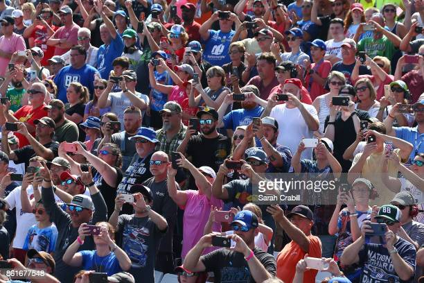 Fans watch during the Monster Energy NASCAR Cup Series Alabama 500 at Talladega Superspeedway on October 15 2017 in Talladega Alabama