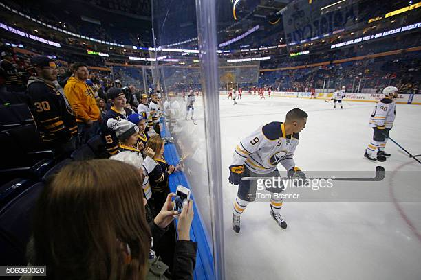 Fans watch Evander Kane of the Buffalo Sabres play with a puck during warmups before the game against the Detroit Red Wings on Friday January 22 2016...