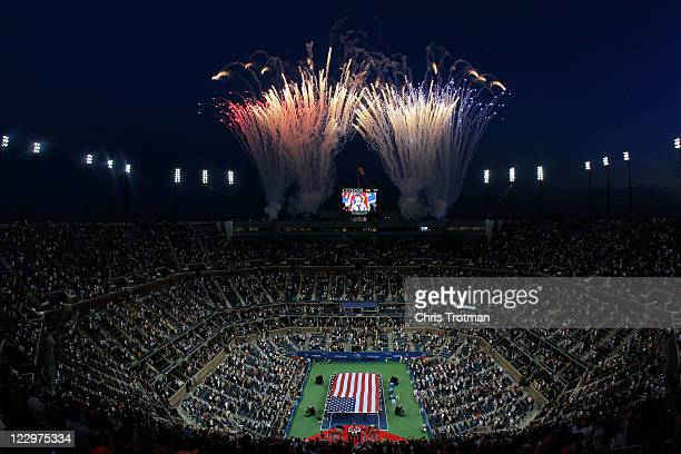 Fans watch fireworks shoot off during the opening ceremony of Day One of the 2011 US Open at the USTA Billie Jean King National Tennis Center on...
