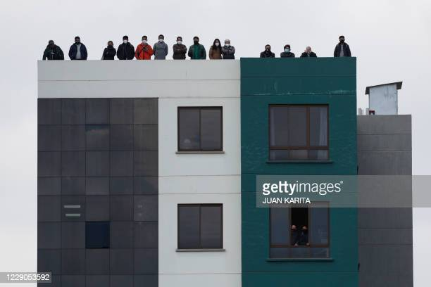 Fans watch from a nearby building, the 2022 FIFA World Cup South American qualifier football match between Bolivia and Argentina at the Hernando...