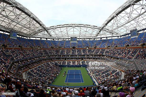 Fans watch from Arthur Ashe Stadium as Venus Williams of the United States plays against Monica Puig of Puerto Rico during her Women's Singles First...