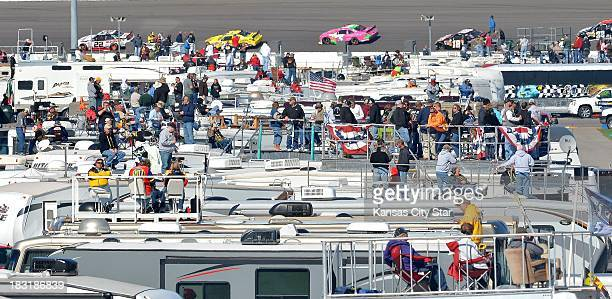 Fans watch from the rooftops of their campers in the infield during the Nationwide Series race on Saturday October 5 at the Kansas Speedway in Kansas...