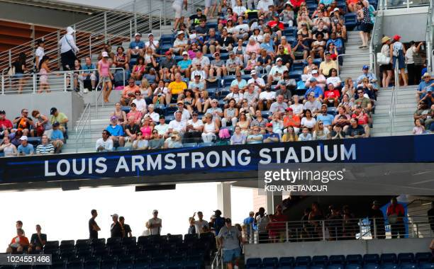 Fans watch from the seats in the new Louis Armstrong stadium as Kaia Kanepi of Estonia plays number 1 seeded Simona Halep of Romania at the 2018 US...