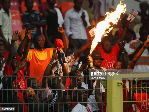 Fans watch from the stand during the preseason friendly match between Manchester United and Portsmouth during their preseason tour to South Africa...