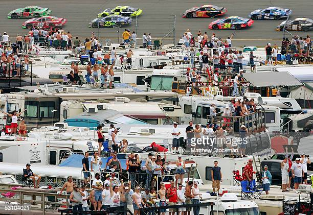 Fans watch from the tops of their motor homes in the infield area during the first laps of the Batman Begins 400 on June 19 2005 at Michigan...