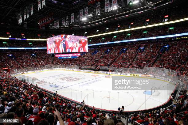 Fans watch Game Seven of the Eastern Conference Semifinals between the Montreal Canadiens and the Pittsburgh Penguins on the Bell Centre video system...