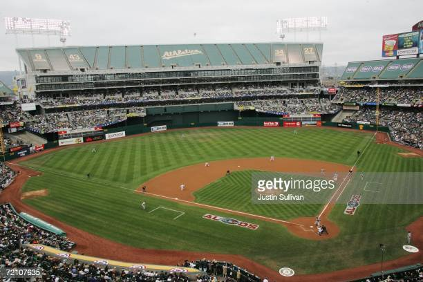 Fans watch game three of the American League Division Series between the Oakland Athletics and the Minnesota Twins at McAfee Coliseum on October 6,...