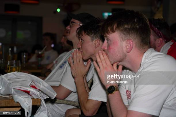 Fans watch in anguish during the UEFA Euro 2020 Championship Final between Italy and England at Fistral Beach Bar on July 11, 2021 in Newquay, United...