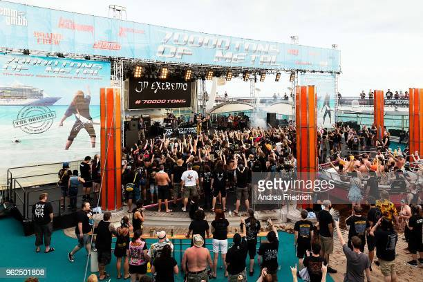 Fans watch In Extremo perform on the pool deck stage onboard the cruise liner 'Independence of the Seas' during the '70000 Tons of Metal' Heavy Metal...