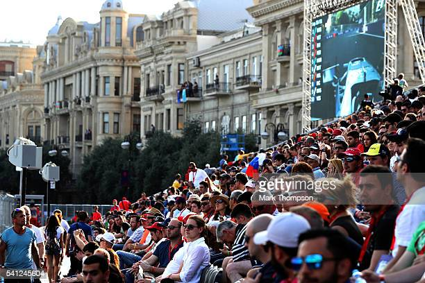Fans watch in the grandstands during the European Formula One Grand Prix at Baku City Circuit on June 19 2016 in Baku Azerbaijan