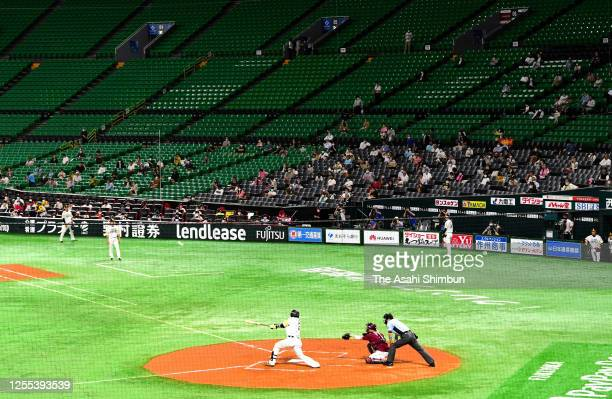 Fans watch in the stand during the game between Tohoku Rakuten Golden Eagles and Fukuoka SoftBank Hawks at the Fukuoka PayPay Dome on July 10, 2020...