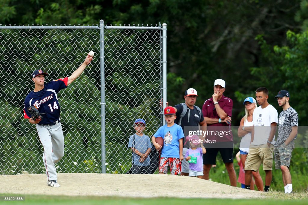 Fans watch Jared Skolnicki of the Bourne Braves warm up in the bullpen during game one of the Cape Cod League Championship Series at Stony Brook Field on August 11, 2017 in Brewster, Massachusetts. The Cape Cod League was founded in 1885 and is the premier summer baseball league for college athletes. Over 1100 of these student athletes have gone on to compete in MLB including Chris Sale, Carlton Fisk, Joe Girardi, Nomar Garciaparra and Jason Varitek. The chance to see future big league stars up close makes Cape Cod League games a popular activity for the families in each of the 10 towns on the Cape to host a team. Each team is a non-profit organization, relying on labor from volunteers and donations from spectators to run each year.