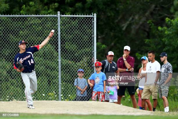 Fans watch Jared Skolnicki of the Bourne Braves warm up in the bullpen during game one of the Cape Cod League Championship Series at Stony Brook...