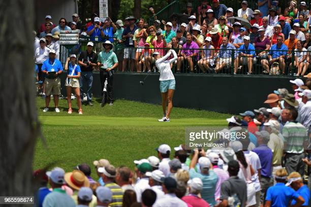 Fans watch Jessica Korda play her tee shot on the first hole during the second round of the 2018 US Women's Open at Shoal Creek on June1 2018 in...