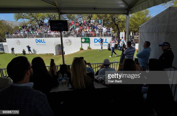 Fans watch Jordan Spieth hitting a tee shot on the first hole during round one of the World Golf ChampionshipsDell Technologies Match Play at Austin...