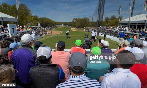 Fans watch Jordan Spieth hitting a tee shot on the seventh hole during round one of the World Golf ChampionshipsDell Technologies Match Play at...