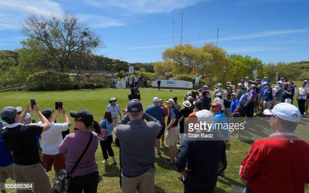 Fans watch Jordan Spieth hitting a tee shot on the sixth hole during round one of the World Golf ChampionshipsDell Technologies Match Play at Austin...