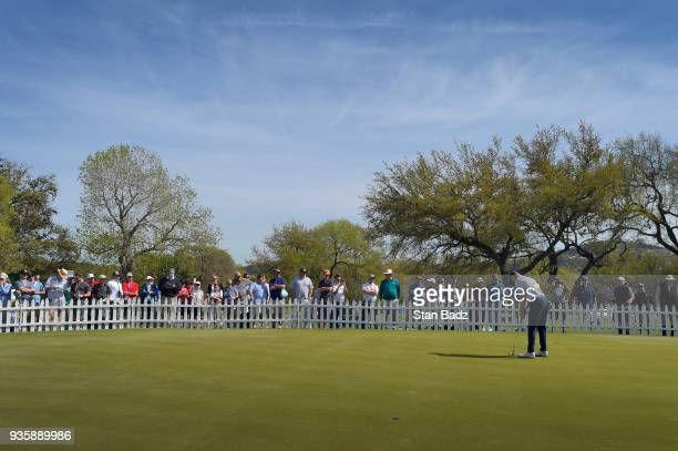Fans watch Jordan Spieth hitting practice putts before round one of the World Golf ChampionshipsDell Technologies Match Play at Austin Country Club...