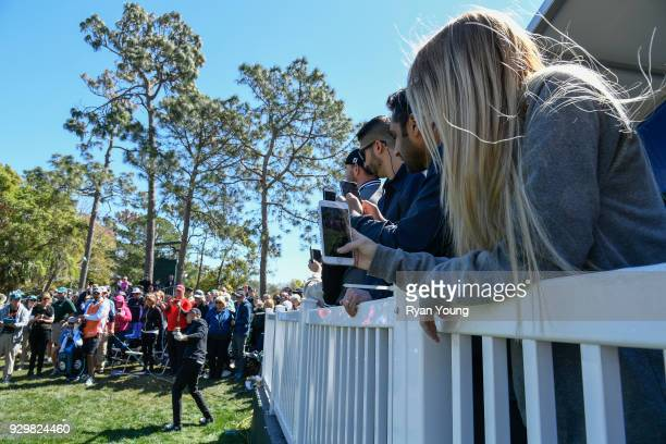 Fans watch Jordan Spieth play a recover shot on the fourth hole during the second round of the Valspar Championship at Innisbrook Resort on March 9...