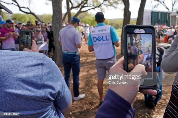 Fans watch Jordan Spieth play from the trees during round one of the World Golf ChampionshipDell Technologies Match Play at Austin Country Club on...