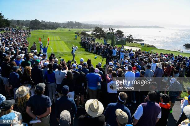 Fans watch Jordan Spieth tee off on the ninth hole during the third round of the ATT Pebble Beach ProAm at Pebble Beach Golf Links on February 10...
