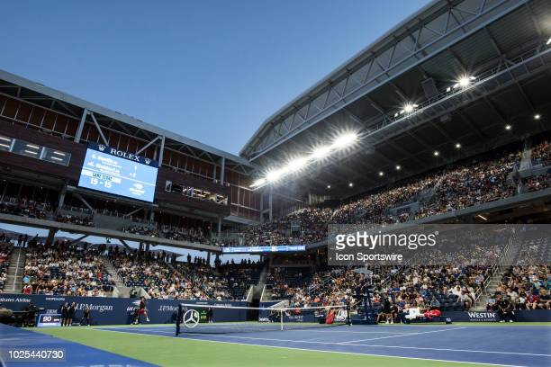 Fans watch Kei Nishikori play his second round match in the Men's Singles Championships during the US Open at the new $200 million Louis Armstrong...