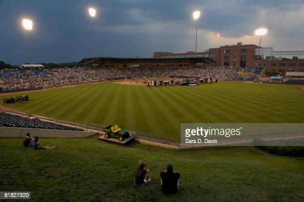 Fans watch Kevin Costner perform with his band Modern West during a July Fourth celebration at the Durham Bulls Athletic Park in Durham North...
