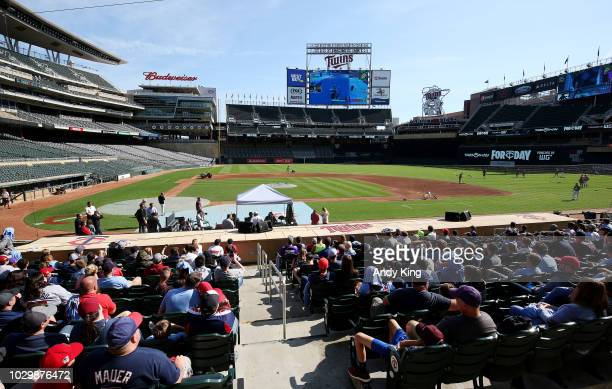Fans watch Minnesota Twins pitcher Trevor May play the video game Fortnite with the game projected on the stadium screen before the Minnesota Twins...
