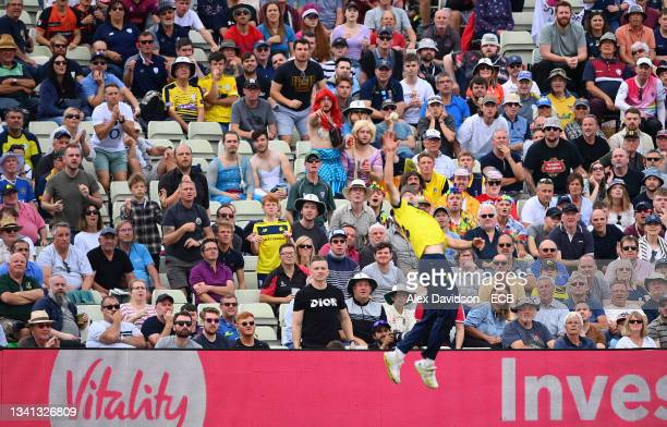 Fans watch on as James Fuller of Hampshire attempts a catch during the Semi-Final of the Vitality T20 Blast match between Hampshire Hawks and...