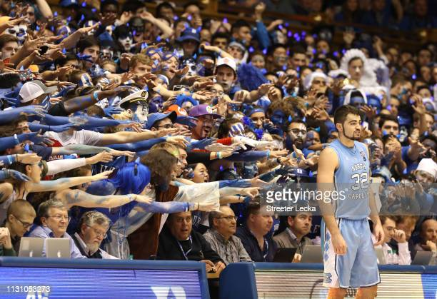 Fans watch on as Luke Maye of the North Carolina Tar Heels waits to throw the ball in bounds against the Duke Blue Devils during their game at...