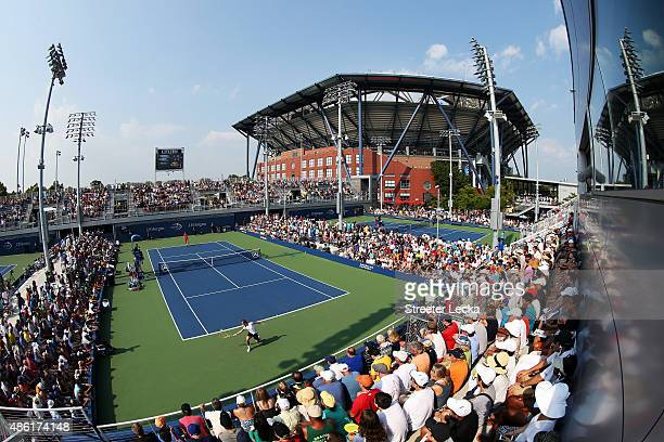 Fans watch on court five as Richard Gasquet of France returns a shot against Thanasi Kokkinakis of Australia during their Men's Singles First Round...