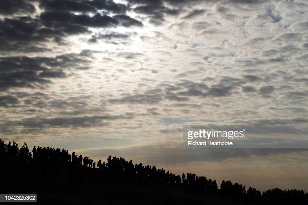 Fans watch on during the morning fourball matches of the 2018 Ryder Cup at Le Golf National on September 28, 2018 in Paris, France.
