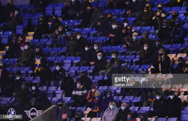 Fans watch on during the Sky Bet League One match between Shrewsbury Town and Accrington Stanley at Montgomery Waters Meadow on December 02, 2020 in...