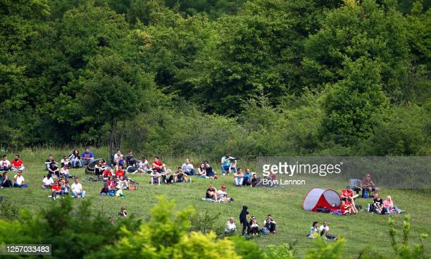 Fans watch on from a hill outside the circuit during the Formula One Grand Prix of Hungary at Hungaroring on July 19, 2020 in Budapest, Hungary.