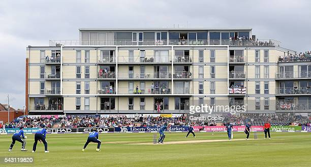 Fans watch on from overlooking flats as Chris Woakes of England bowl to Kusal Mendis of Sri Lanka during the 3rd ODI Royal London One Day...