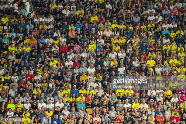 Fans watch on from the stand during the Liga match between Villarreal CF and Real Madrid CF at Estadio de la Ceramica on September 01, 2019 in...