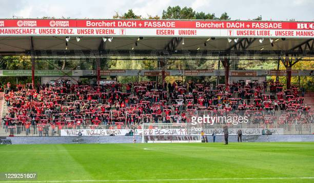 Fans watch on from the stands during the Bundesliga match between 1. FC Union Berlin and Sport-Club Freiburg at Stadion An der Alten Foersterei on...