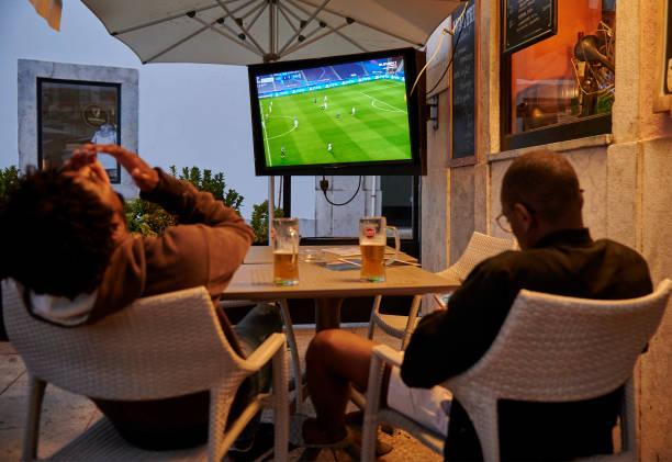 PRT: Fans Watch The UEFA Champions League Quarter Final