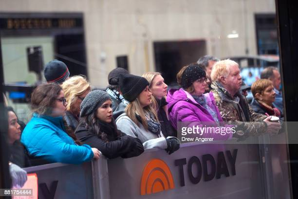 Fans watch outside of the set of NBC's Today Show November 29 2017 in New York City It was announced on Wednesday morning that long time Today Show...