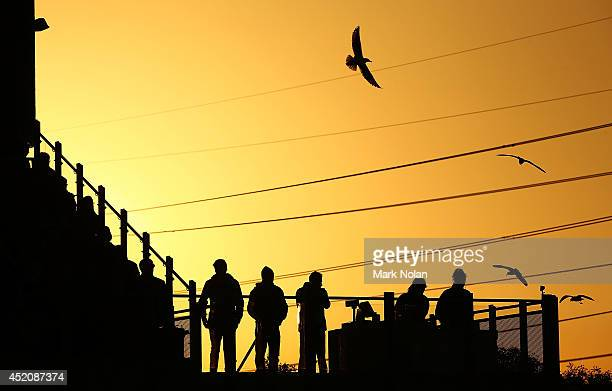 Fans watch over the ground during the round 18 NRL match between the Cronulla Sharks and the Newcastle Knights at Remondis Stadium on July 13 2014 in...