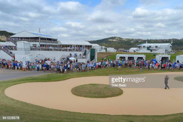 Fans watch Patrick Reed hitting from a bunker on the 12th hole during round three of the World Golf ChampionshipsDell Technologies Match Play at...