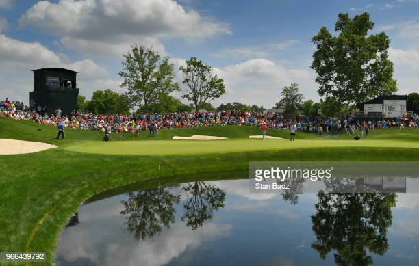 Fans watch Patrick Reed playing a chip shot onthe 16th hole during the third round of the Memorial Tournament presented by Nationwide at Muirfield...