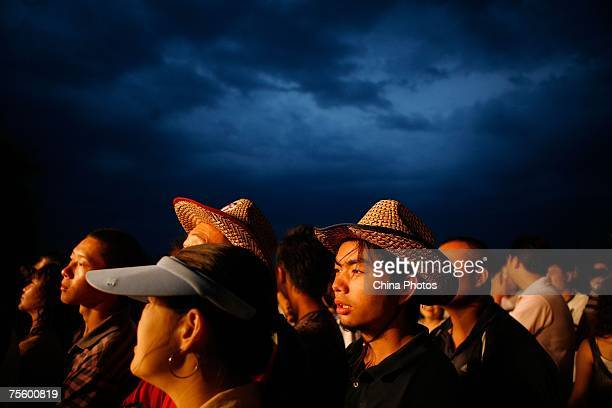 Fans watch performance at the first 'Green Flag Erdos Grassland Rock Music Festival' near the Mausoleum of Genghis Khan on July 21 2007 in Erdos of...