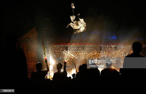 Fans watch performance at the first 'Green Flag Erdos Grassland Rock Music Festival' near the Mausoleum of Genghis Khan on July 20 2007 in Erdos of...