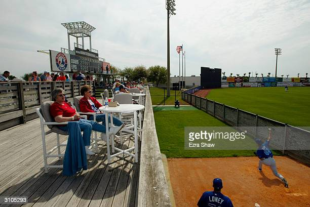 Fans watch pitcher Masao Kida of the Los Angeles Dodgers warmup during the Spring Training game against the Montreal Expos on March 9 2004 at Space...