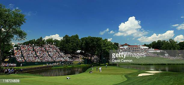 Fans watch play around the 18th green during the second round of the 111th US Open at Congressional Country Club on June 17 2011 in Bethesda Maryland