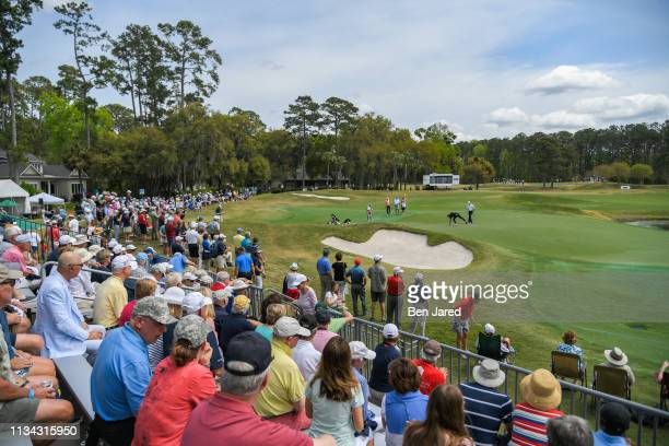 Fans watch play around the fifth hole green during the final round of the Web.com Tour Savannah Golf Championship at the Landings Club Deer Creek...